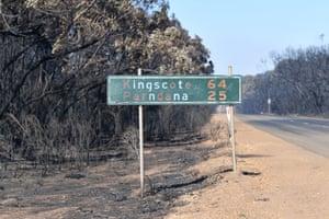 Burned-out bush and road sign on Kangaroo Island