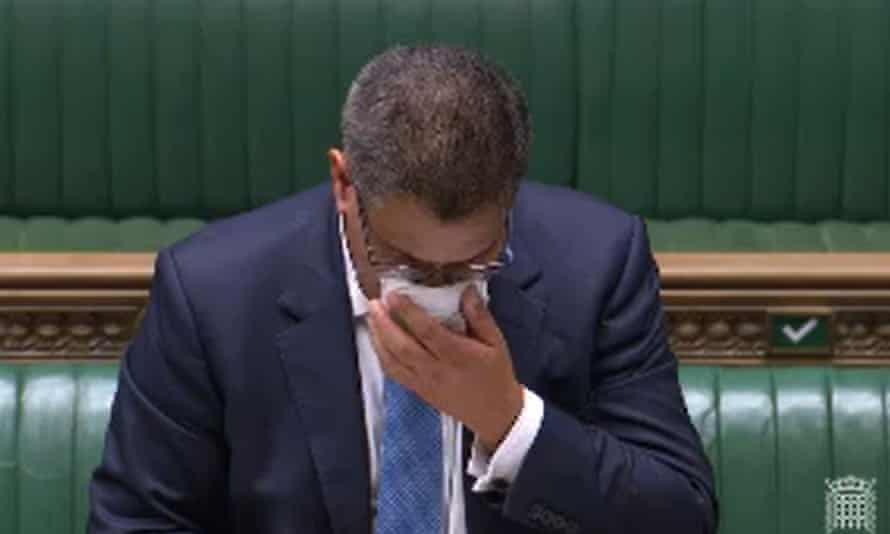 Alok Sharma wipes his face during a speech in the House of Commons.