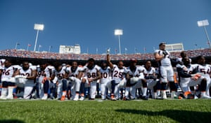 The Denver Broncos take a knee during the national anthem before their game against the the Buffalo Bills on 24 September at New Era Field in Orchard Park in New York