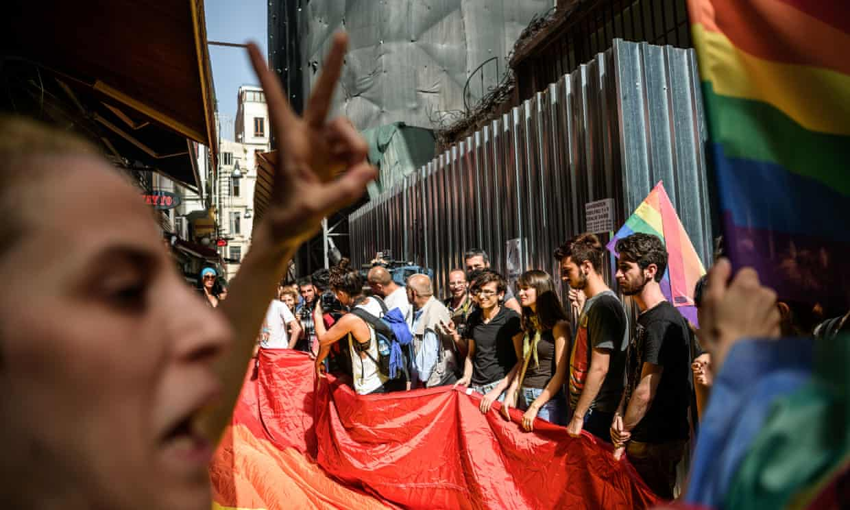 Turkish riot police officers fire rubber bullets at demonstrators during an LGBT rally on Istiklal Avenue, Istanbul