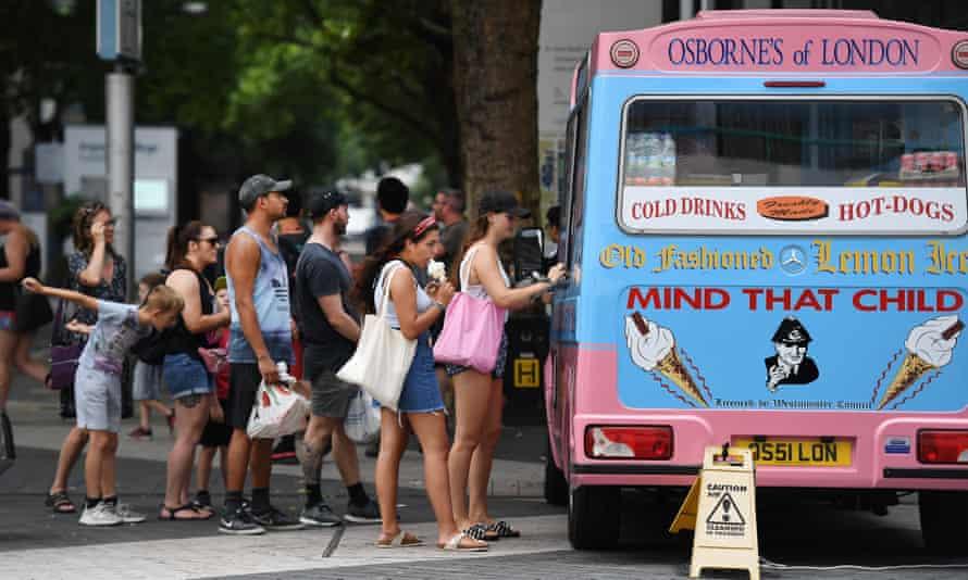 People queue at an ice-cream van in London, 25 July 2019