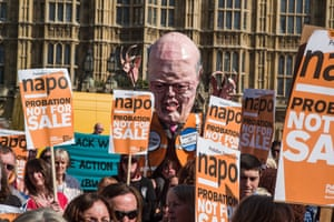 A protest outside parliament against probation services reforms brought in by Chris Grayling. An effigy of Grayling is in the background