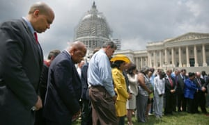 Members of Congress hold a prayer circle in front of the US Capitol to honour those gunned down at the Emanuel church.