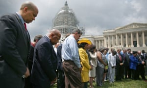 Members of the US Congress during a prayer circle on 18 June 2015 in front of the US Capitol to honour those gunned down last night inside a Charleston church.