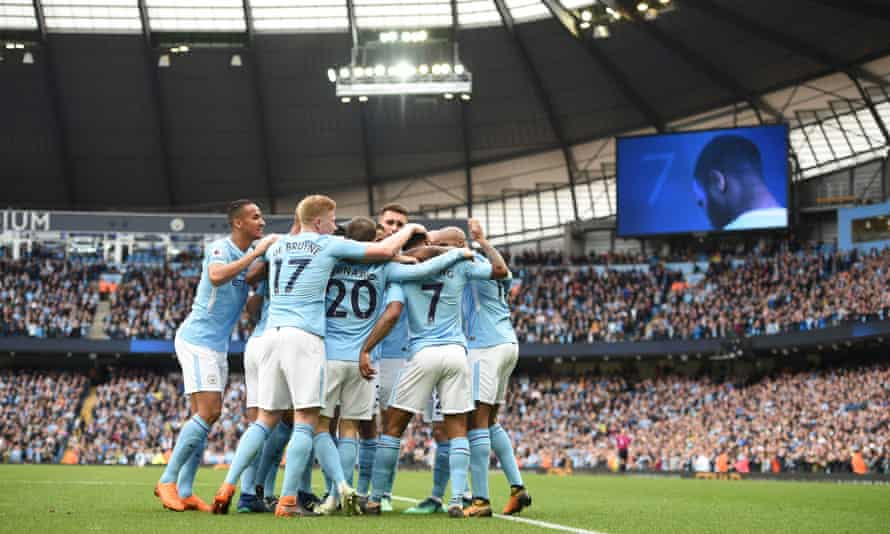 Raheem Sterling is mobbed by his team-mates after scoring Manchester City's second goal in the 5-0 thrashing of Swansea at the Etihad Stadium in April.