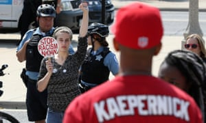 Protesters stage a rally in support of Colin Kaepernick, outside Soldier Field in Chicag