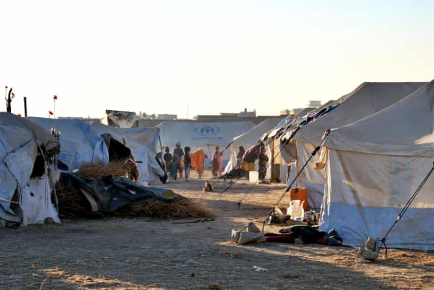 Children play inside an IDP camp on the outskirts of Kandahar city; 250 families are housed in a space of 4,000 sq metres.