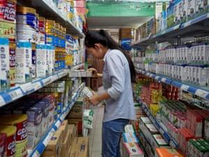 Shop worker Hong An at a Vinamilk store in Ho Chi Minh City