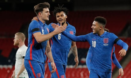Harry Maguire celebrates with Tyrone Mings and Jadon Sancho after scoring England's opening goal against Republic of Ireland.