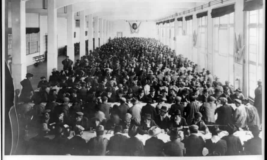 Migrant men sit at crowded tables at the Hotel de Inmigrantes in Buenos Aires, which functioned as Argentina's Ellis Island.