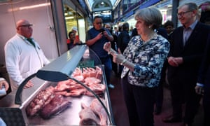 Theresa May and her husband Philip at Smithfield Market during June's general election campaign.