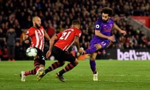 Mohamed Salah sweeps home a sublime goal.