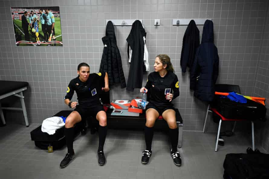 French referee Stephanie Frappart speaks with her assistant Manuela Nicolosi before the French Ligue 2 match between Valenciennes and Beziers.