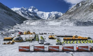 In this 30 April, 2020, aerial file photo released by China's Xinhua news agency, vehicles and tents are seen at the base camp at the foot of the Chinese side of the peak of Mount Qomolangma, also known as Mount Everest, in southwestern China's Tibet autonomous region.