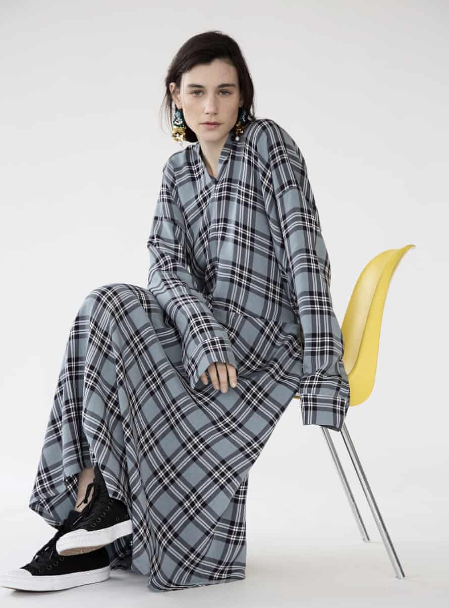 Sara Lanzi's check chemisier, worn with embroidered earrings.