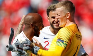 England's Jordan Pickford celebrates with Fabian Delph and Kyle Walker after the match.