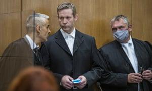 Stephan Ernst, centre, arrives in court.