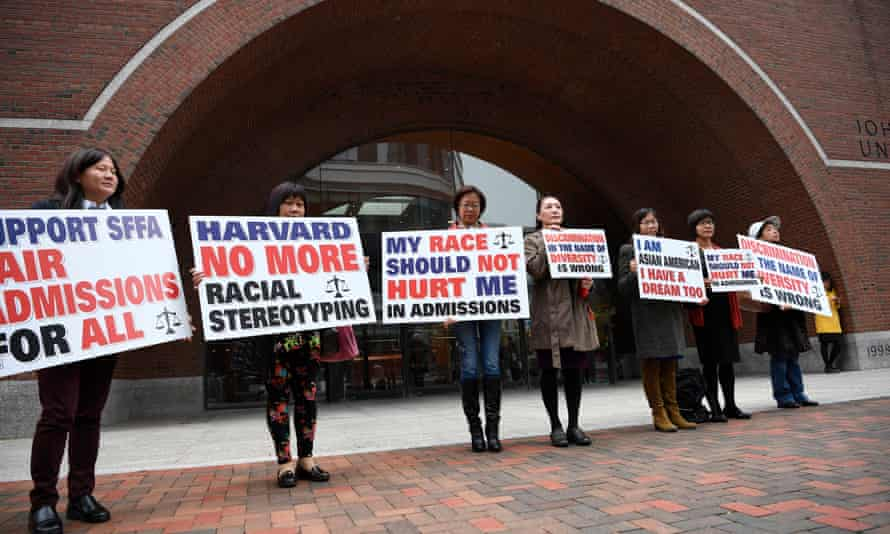 Demonstrators hold slogans in front of a courthouse in Boston, Massachusetts, on 15 October.