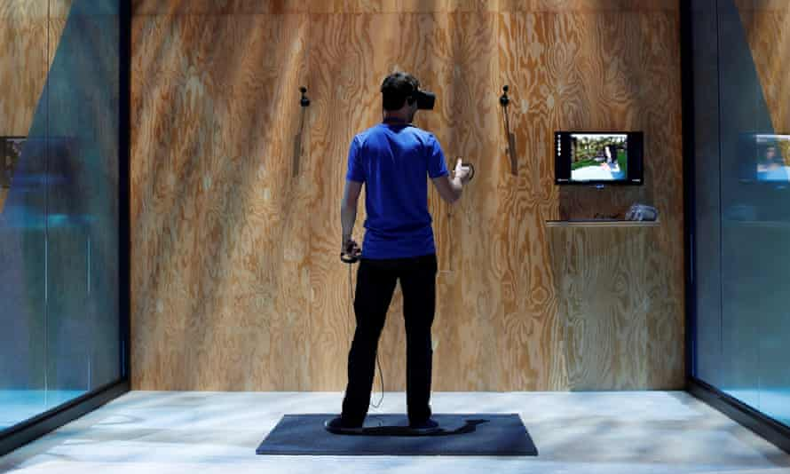 An attendee tries the new Facebook Spaces virtual reality platform during the annual Facebook F8 developers conference in San Jose, California.