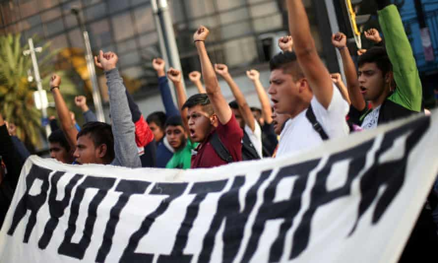 Students participate in a march in Mexico City on 26 February to mark the 65th month since the disappearance of the 43 missing Ayotzinapa College students.