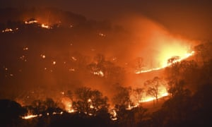 Spot fires burn on a hillside caused by a lightning strike along Marsh Creek Road in Brentwood, California on Monday.