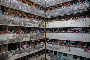 Mumbai, India. People bang utensils and clap from the balconies of a residential building to thank the medical staff and others working to keep Indians safe