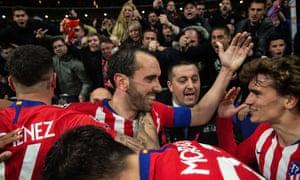Atletico Madrid's defender Diego Godin celebrates after scoring their second goal.