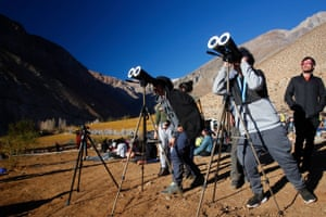Chileans watch the sky with binoculars prior to the solar eclipse in Paiguano, Chile.