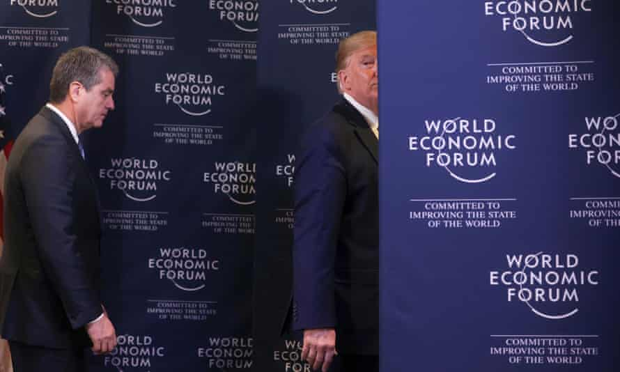 Donald Trump, right, exits a news conference with director-general of the World Trade Organization Roberto Azevêdo last January.