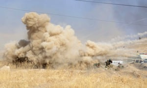 Smoke rises after a suicide bomb attack against Kurdish forces near Mosul.