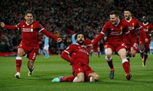 Liverpool's Mohamed Salah celebrates with Roberto Firmino and Andrew Robertson after scoring their first goal.