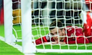 Andrew Robertson of Liverpool reacts after the second AC Milan goal scored by Brahim Diaz.