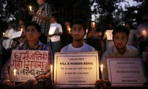 People hold a candlelit vigil in 2015 in memory of a Muslim farmer who was lynched by a mob