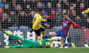 Crystal Palace's Vicente Guaita makes a save from Arsenal's Alexandre Lacazette.