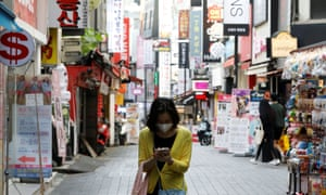 A woman in Myeongdong shopping district in Seoul, South Korea.