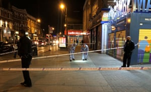 London, UKPolice activity at a cordoned off area in High Road, Tottenham, after a suspected stabbing