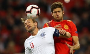 Harry Kane tries to get his head to the ball.