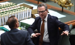 Christopher Pyne speaks to Tony Abbott during question time on Thursday.