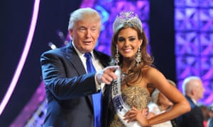 Donald Trump, left, and Erin Brady pose onstage after Brady won the 2013 Miss USA pageant in Las Vegas.