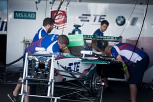 Mechanics work on an Andretti ATEC-02 electric car before the race