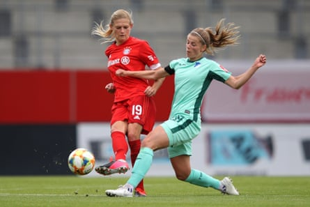 Carina Wenninger battles for the ball with Tabea Wassmuth of TSG 1899 Hoffenheim during the Frauen Bundesliga match in May.