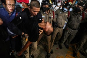 A pro-democracy activist is carried into a hospital vehicle in Bangkok, Thailand