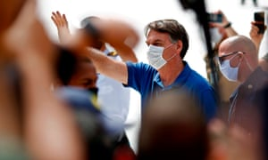 Jair Bolsonaro waves to supporters during a rally in Brasília on 17 May.