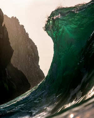 Wave with a mountain in the backdrop