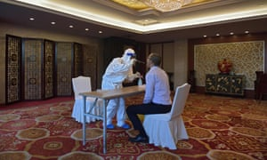 A Covid test being performed in Beijing, a day ahead of a ceremony to honour people who were involved in the fight against the coronavirus.