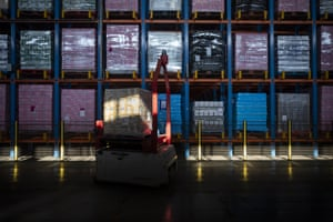 An automated truck transports a crate of retail goods before export to the U.K. inside the ECS European Containers NV computerized warehouse in Zeebrugge.