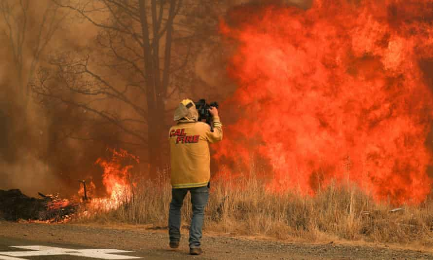 Tim Walton, an NBC News cameraman, covers the LNU Lightning Complex fire in Lake county, California, on 23 August.