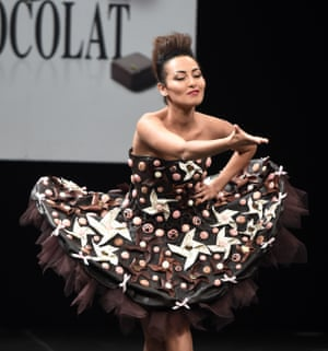 French TV host Hedia Charni in a chocolate dress during the Paris chocolate fair