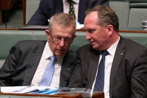 Deputy Prime Minister Barnaby Joyce talks to Mark Coulton from the neighbouring electorate of Parkes during question time in the House of Representatives in Canberra this afternoon, Tuesday 15th March 2016.