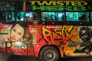 Passengers wait inside a matatu fitted with lights and a sound system for more passengers to board